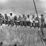 29 Sep 1932 --- Construction workers eat their lunches atop a steel beam 800 feet above ground, at the building site of the RCA Building in Rockefeller Center. --- Image by © Bettmann/CORBIS Wikimedia Commons/Fair Use
